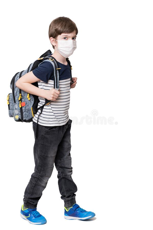 Kid with face mask holding school bag royalty free stock photo