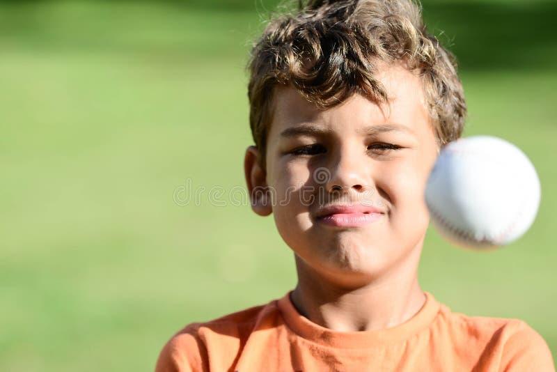 Kid with facial expressions playin baseball royalty free stock photos