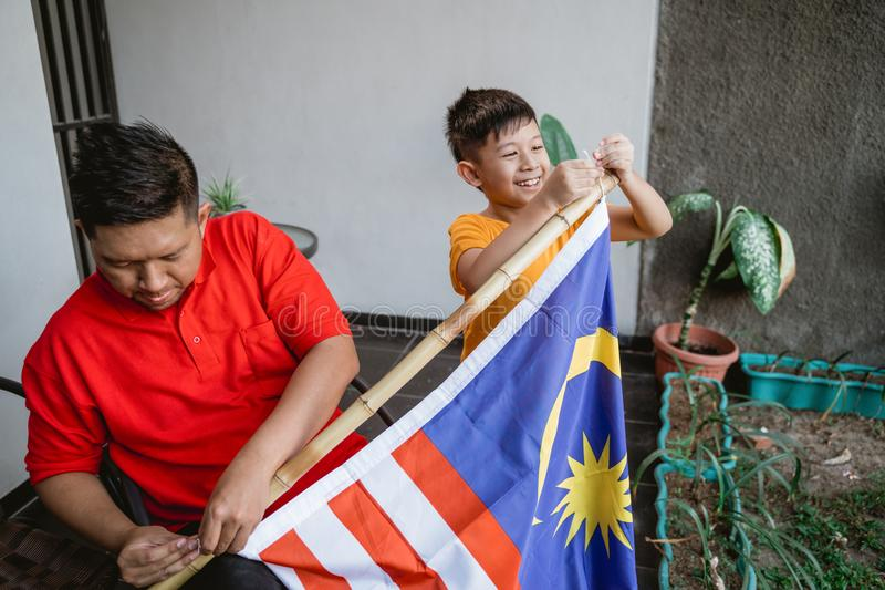 Family celebrating malaysia national independence day stock image