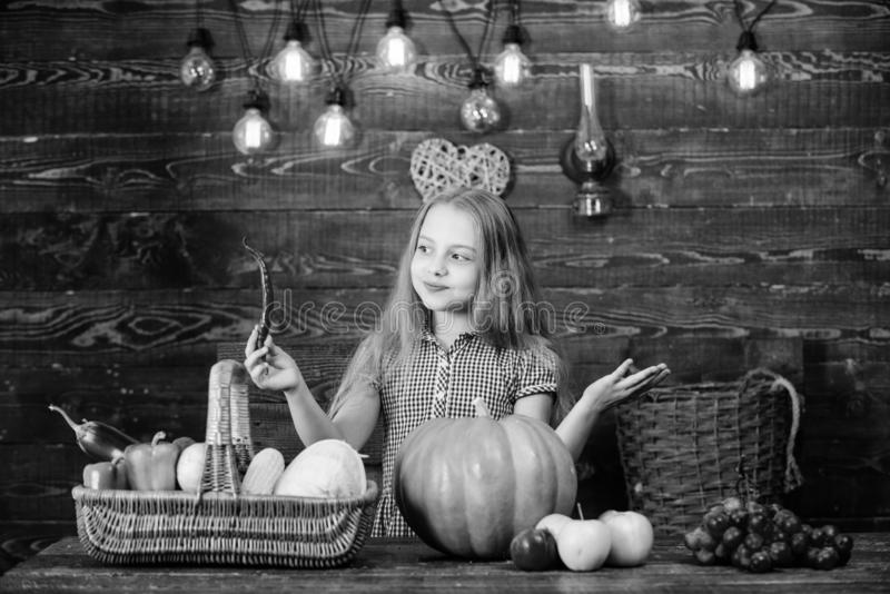Kid farmer with harvest wooden background. Family farm festival concept. Farm themed games and activities for kids. Girl. Kid at farm market with fall harvest stock images