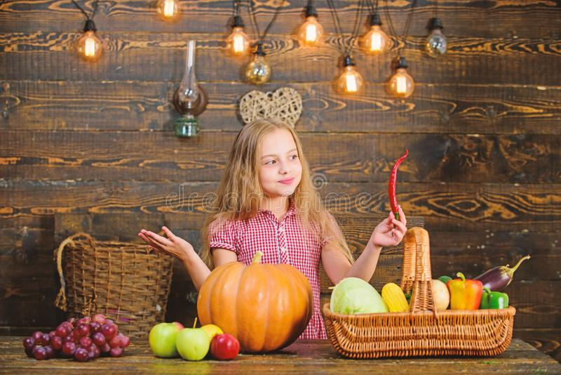 Kid farmer with harvest wooden background. Family farm festival concept. Farm themed games and activities for kids. Girl. Kid at farm market with fall harvest stock photos