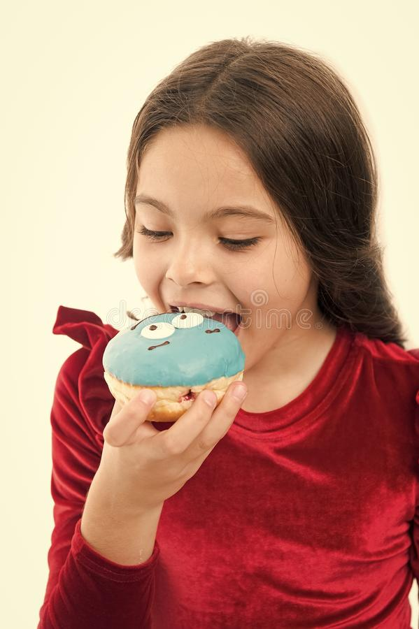 Kid fashion and beauty. childhood and happiness. small child with donat. small girl in red dress. happy childrens day. Sweet life. healthy eating and dieting stock image