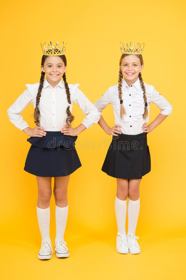 Kid fashion. Friendship. prom queen. childhood pride. education success. back to school. selfish small girls dream about royalty free stock images