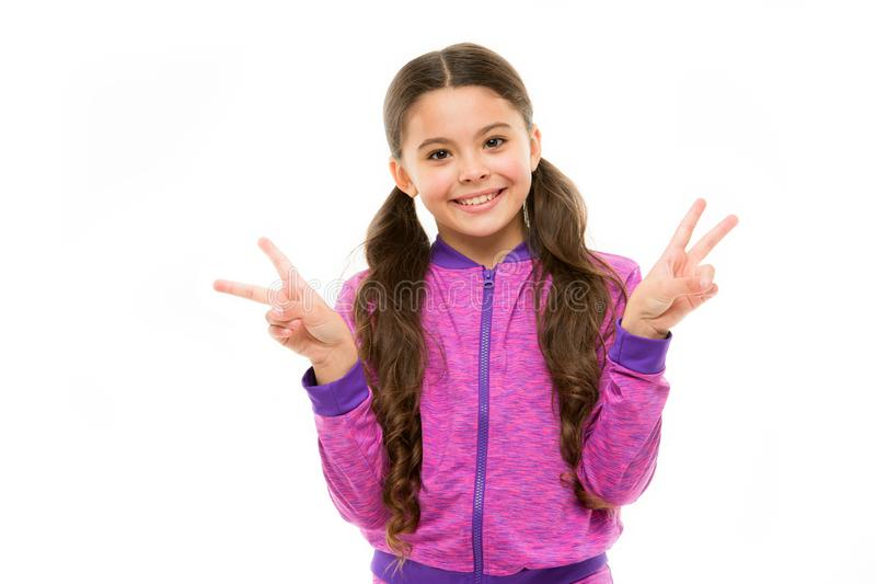 Kid fashion and sportswear. Small girl child. Hairdresser for kids. childrens day. Portrait of happy little child stock photography