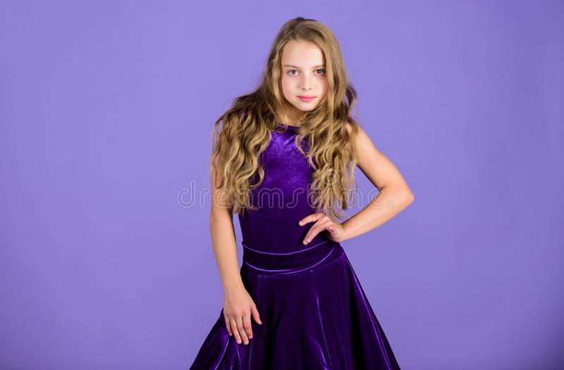 Kid fashionable dress looks adorable. Ballroom dancewear fashion concept. Kid dancer satisfied with concert outfit. Ballroom fashion. Girl child wear velvet royalty free stock images
