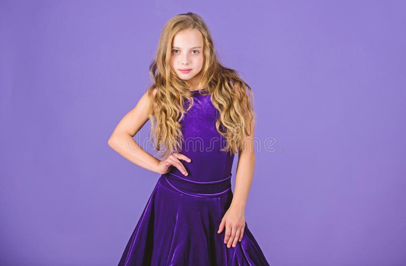 Kid fashionable dress looks adorable. Ballroom dancewear fashion concept. Kid dancer satisfied with concert outfit. Ballroom fashion. Girl child wear velvet royalty free stock photos