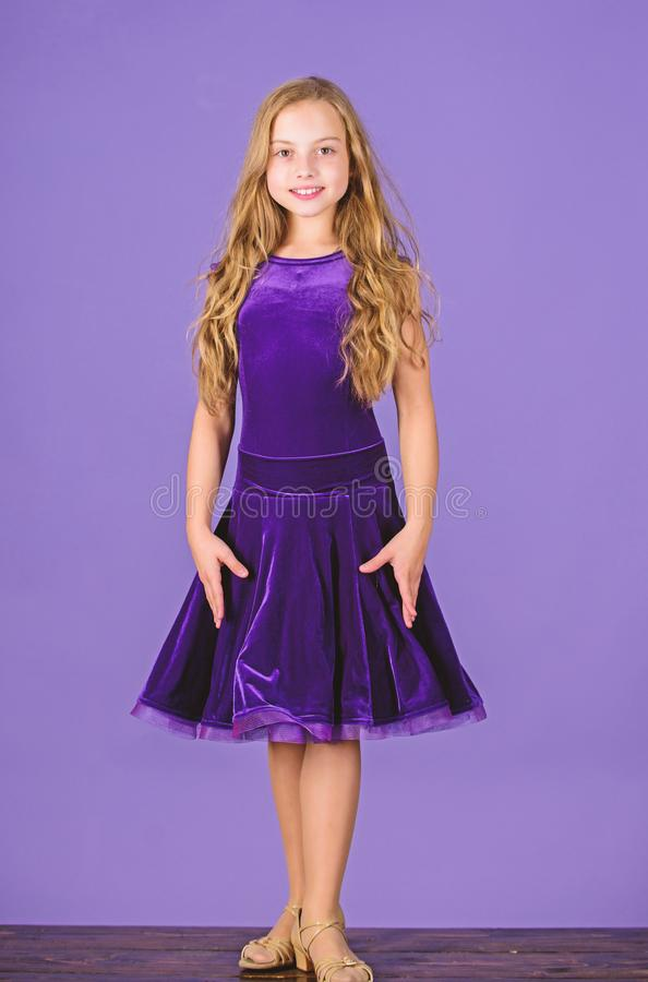 Kid fashionable dress looks adorable. Ballroom dancewear fashion concept. Kid dancer satisfied with concert outfit. Girl stock image