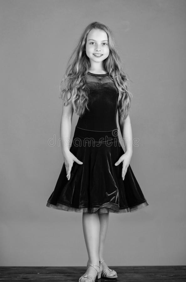 Kid fashionable dress looks adorable. Ballroom dancewear fashion concept. Kid dancer satisfied with concert outfit. Girl stock photos
