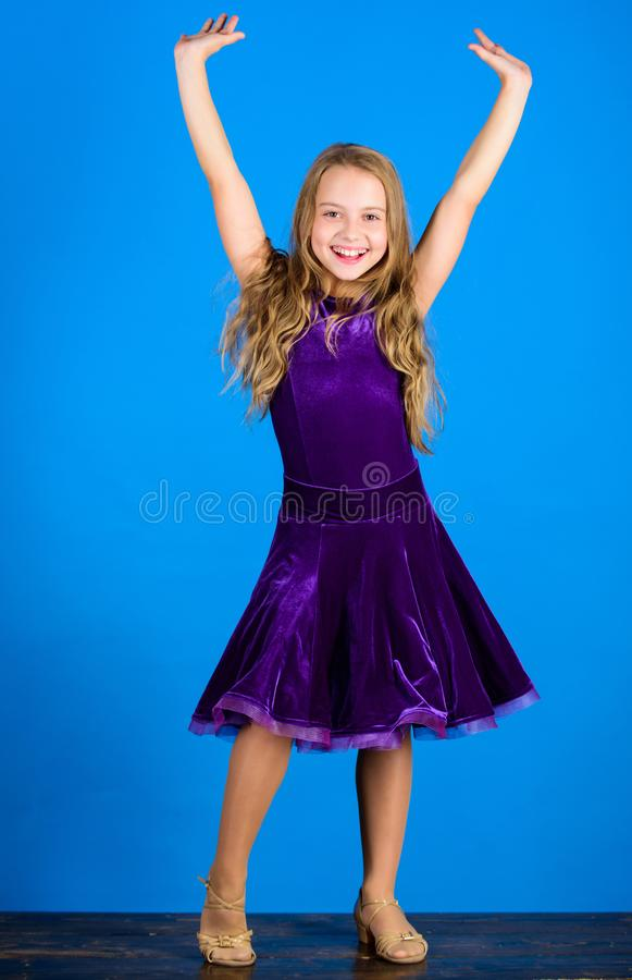 Kid fashionable dress looks adorable. Ballroom dancewear fashion concept. Kid dancer satisfied with concert outfit. Clothes for ballroom dance. Ballroom stock photo