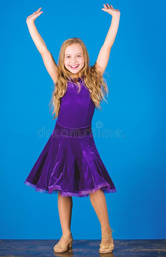Kid fashionable dress looks adorable. Ballroom dancewear fashion concept. Kid dancer satisfied with concert outfit stock photography