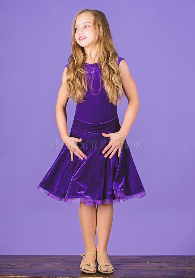 Kid fashionable dress looks adorable. Ballroom dancewear fashion concept. Kid dancer satisfied with concert outfit. Kids. Fashion. Girl cute child wear velvet stock photo