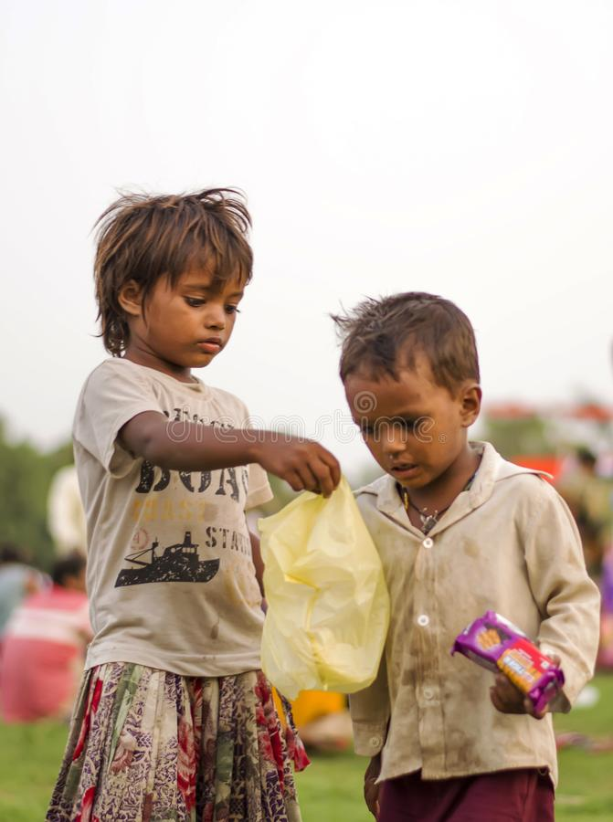 Kid finding food. A poverty due to money is bearable where you have a reason to earn for your happiness and if any case you& x27;re poverty is in terms of stock image