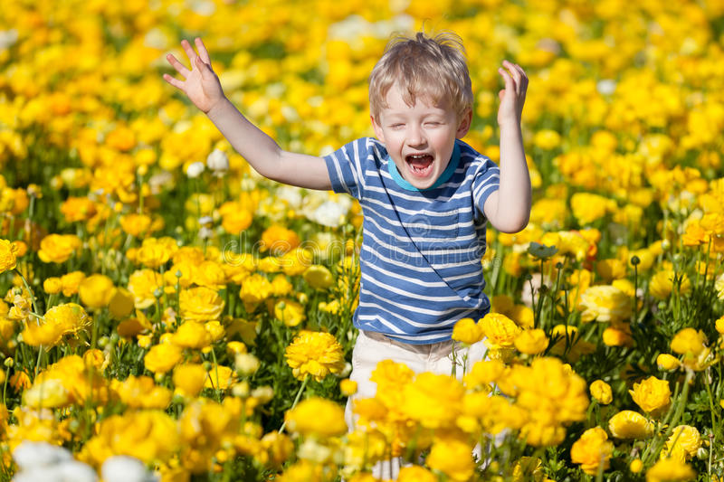 Kid At The Flower Field Royalty Free Stock Photo