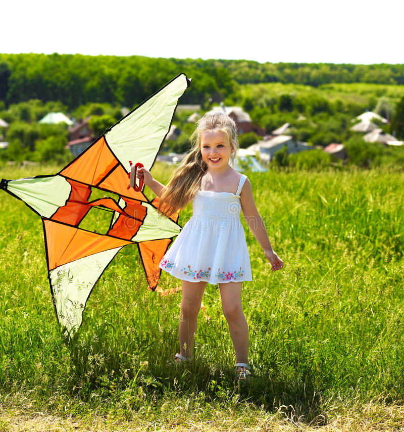 Download Kid Flying Kite Outdoor. Stock Photo - Image: 19937450