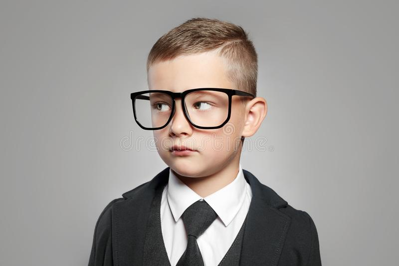 Kid in Formal suit and glasses. Intelligent child in glasses. little boy in Formal suit and glasses. funny kid stock photo