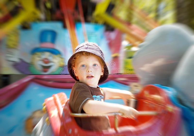 Kid on fun fair ride royalty free stock images