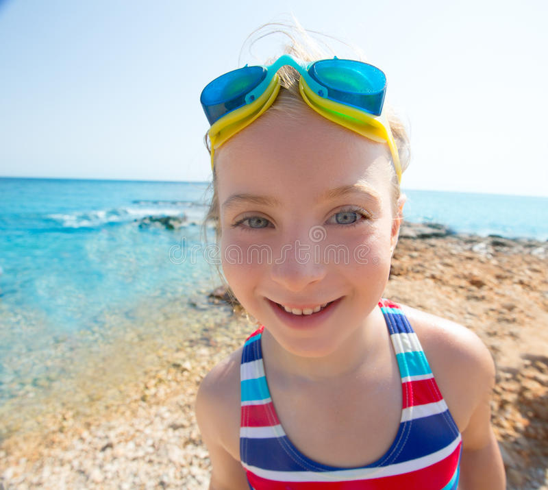 Download Kid Funny Girl Wide Angle Beach Portrait Swimsuit And Goggles Stock Photo - Image: 36147938