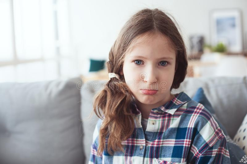 Kid girl asking parents to buy toys or gifts, or saying sorry royalty free stock image