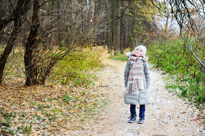 Kid girl in the autumn forest royalty free stock photos