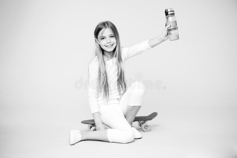 Kid girl care body hydration. Active leisure and water balance. Active and healthy kid drink water. Staying hydrated. Girl happy face holds with water bottle royalty free stock images