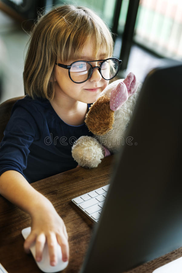 Kid Girl Computer Relax Leisure Concept stock photography