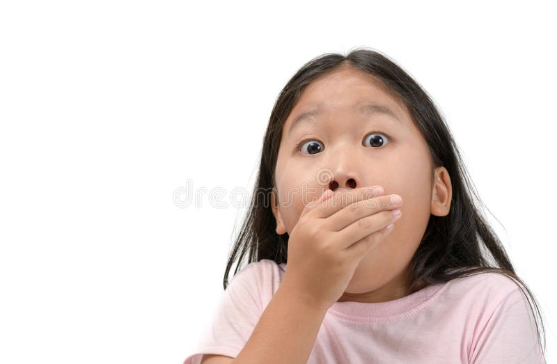 Kid girl covering her mouth isolated stock image