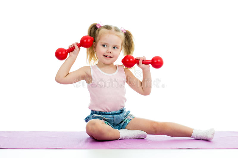 Kid doing exercises with dumbbells stock image