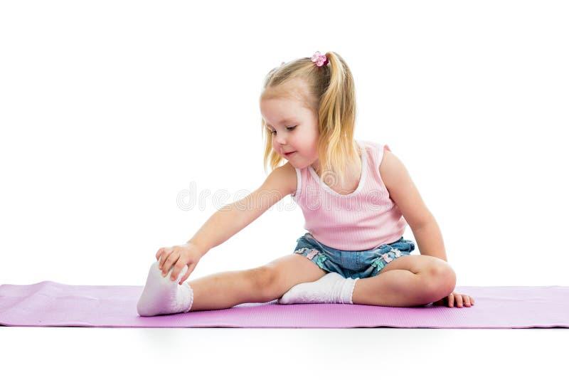 Kid doing fitness exercises. Kid girl doing fitness exercises stock photo