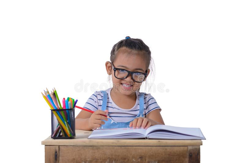 Kid girl drawing with color pencils royalty free stock images