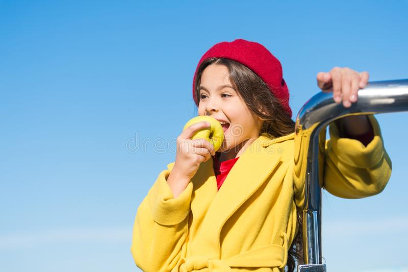 Kid girl eat apple fruit. Healthy diet. Snack while walk. Kids health and nutrition. Healthy snacking benefits. Snack royalty free stock image
