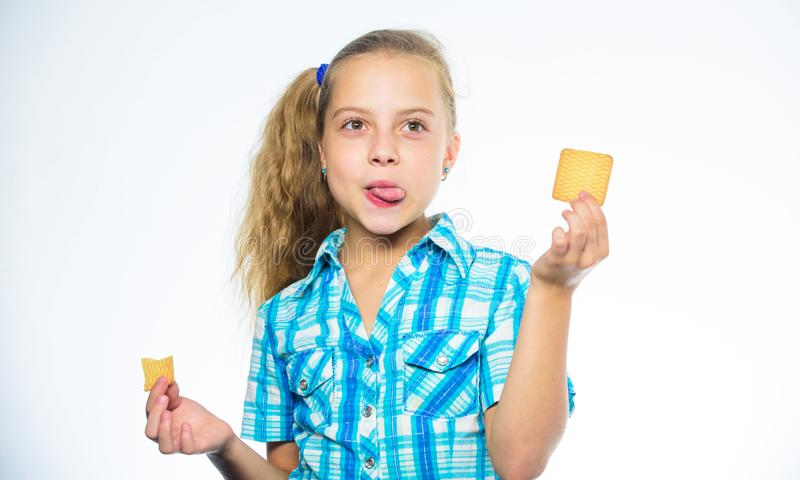 Kid girl eat cookie. Health and dieting concept. Good nutrition is essential to good health. Dieting counting calorie. Break her diet for sweets. Find out stock image
