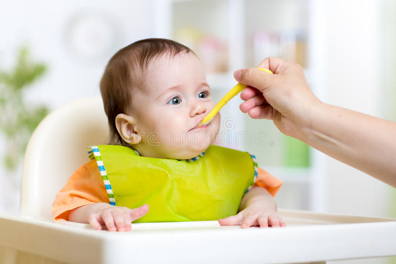 Kid girl eating healthy vegetables royalty free stock photography