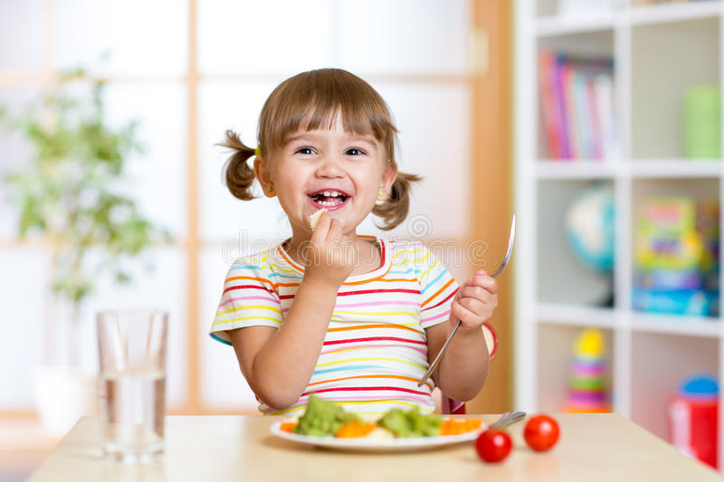 Kid Girl Eating Healthy Vegetables Stock Photo Image Of