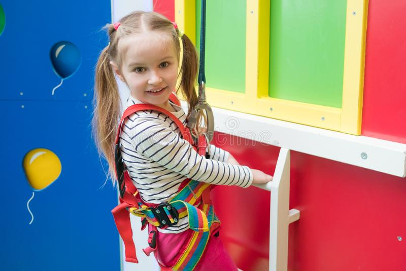 Kid girl in entertainment sports park indoors stock photo