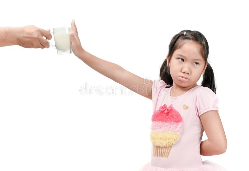 Kid girl with expression of disgust against fresh milk royalty free stock image