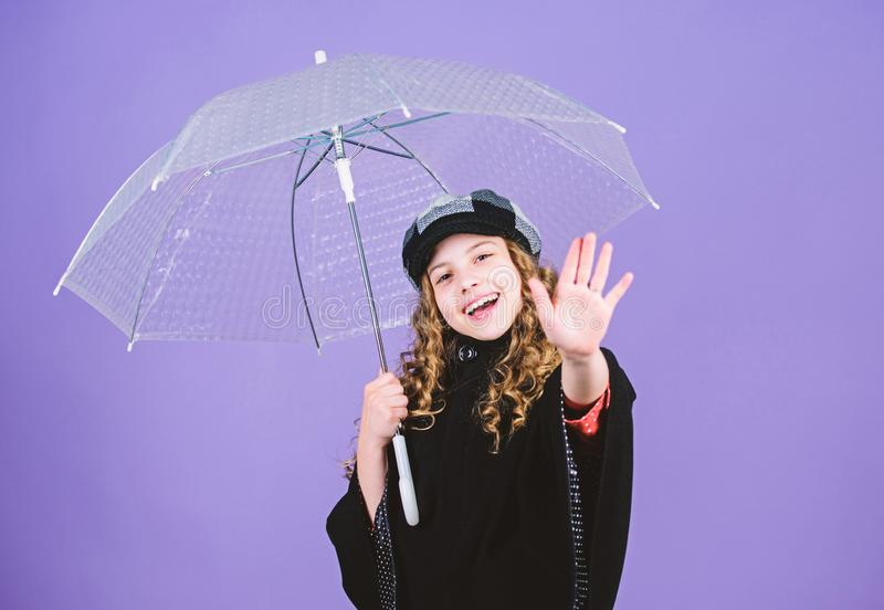 Kid girl happy hold transparent umbrella. Enjoy rainy weather with proper garments. Waterproof accessories make rainy stock image
