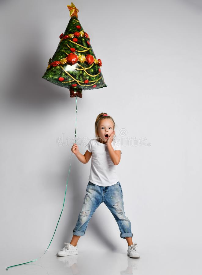 Free Kid Girl In Full Growth With Christmas Tree Air Balloon Is Awing, Surprised, Excited On White With Free Copy Space. Stock Images - 166083684