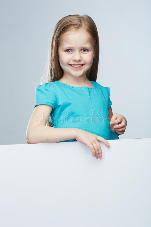 Kid girl isolated against gray background . royalty free stock photos