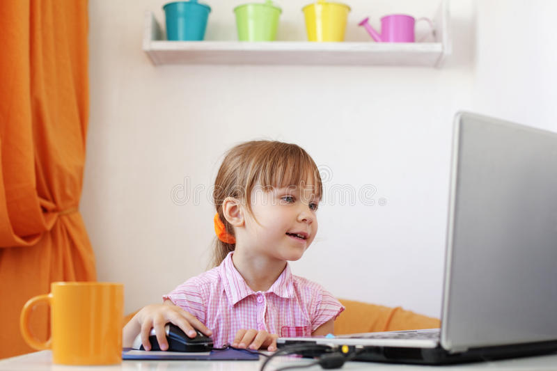 Kid girl with laptop royalty free stock photos