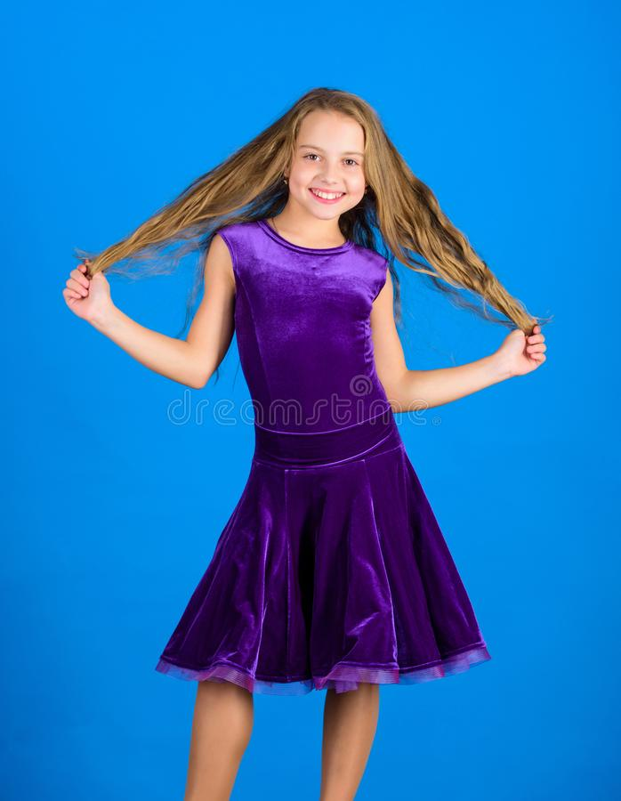 Kid girl with long hair wear dress on blue background. Hairstyle for dancer. How to make tidy hairstyle for kid. Things. You need know about ballroom dance royalty free stock images
