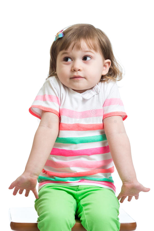 Kid girl looks puzzled, isolated. On white royalty free stock photos