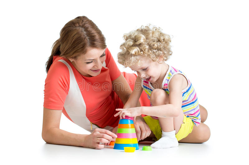 Kid girl and mother play with toys stock photography