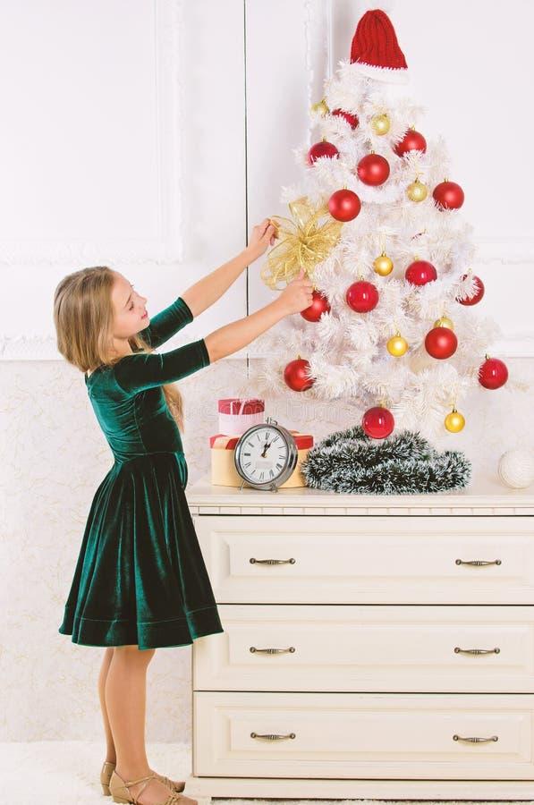 Free Kid Girl Near Christmas Tree Waiting Midnight Clock. Last Preparations. Child Celebrate Christmas At Home. Favorite Day Stock Photo - 175838650