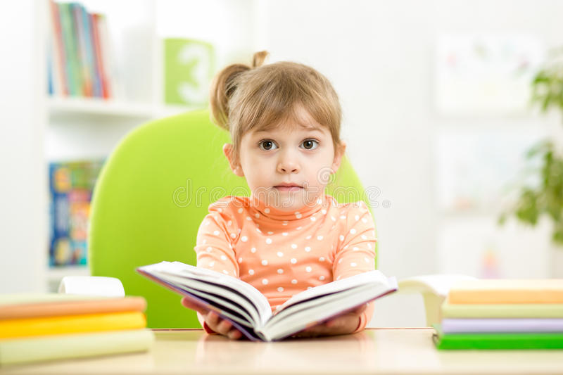 Kid girl with open book royalty free stock images