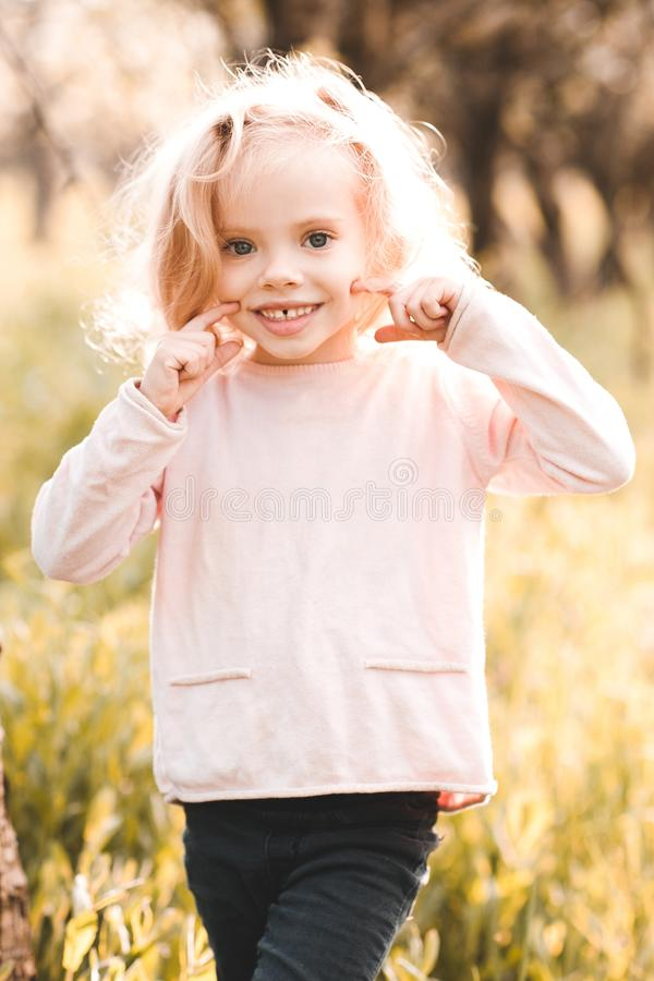 Kid girl outdoors stock photography