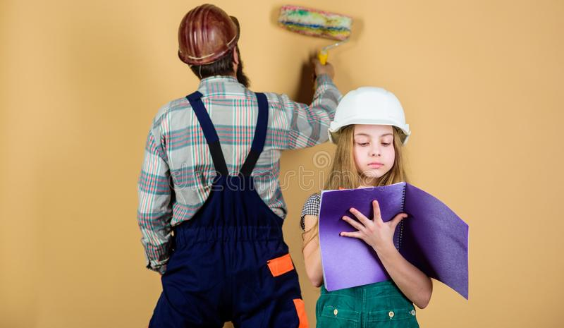 Kid girl planning renovation. Child renovation room. Family remodeling house. Little fathers helper. Father bearded man stock photography