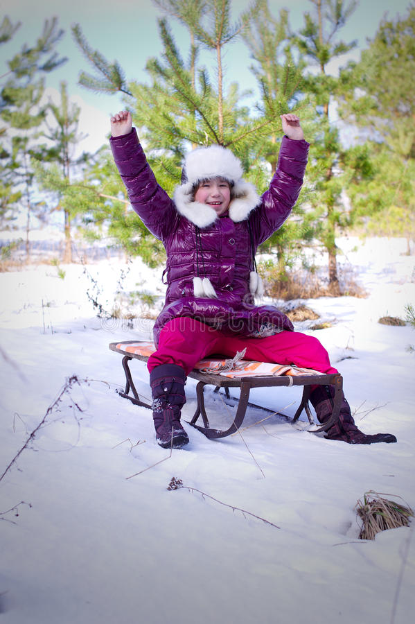 Kid girl slide toboggan hill hands up