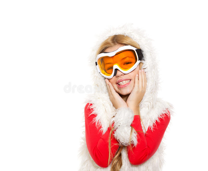 Kid girl with snow winter glasses and white fur. Coat isolated background royalty free stock image