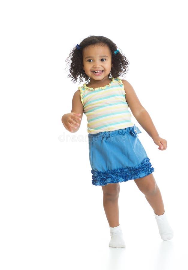Kid girl standing or dancing full length isolated. On white stock photos