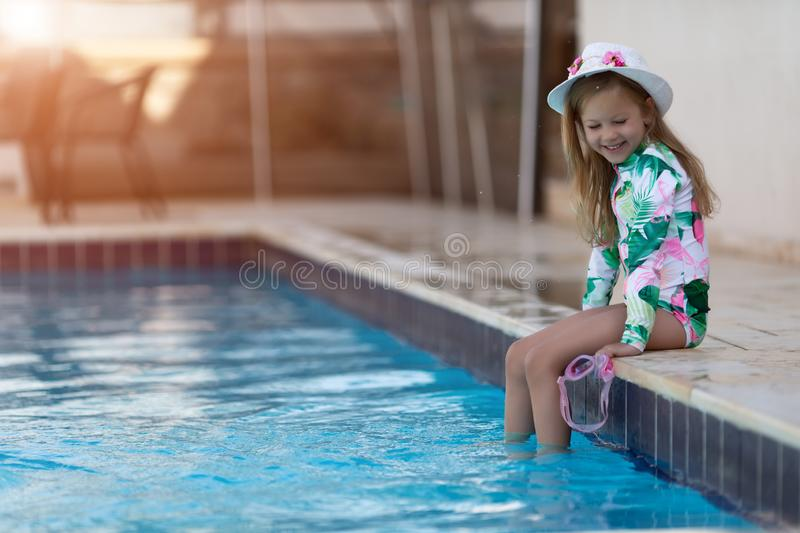 Kid girl with sun protection cream on her skin spends time in the pool. Children, summer, holiday and healthcare concept stock images